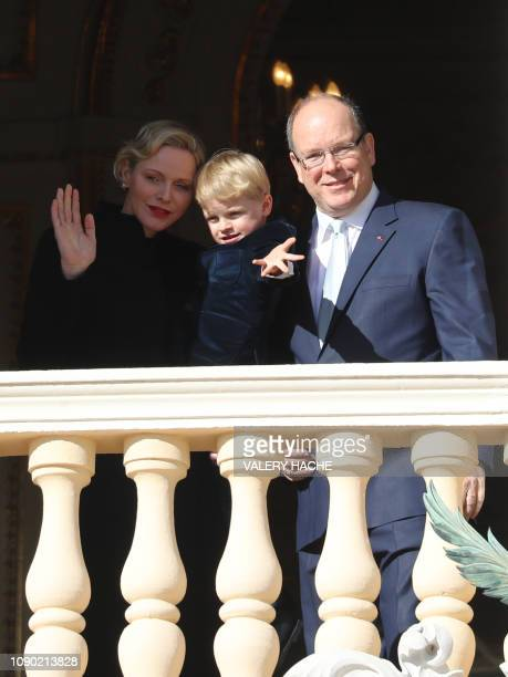 Prince Albert II of Monaco Princess Charlene of Monaco and Prince Jacques appear on the palace's balcony during Sainte Devote Celebrations in Monaco...