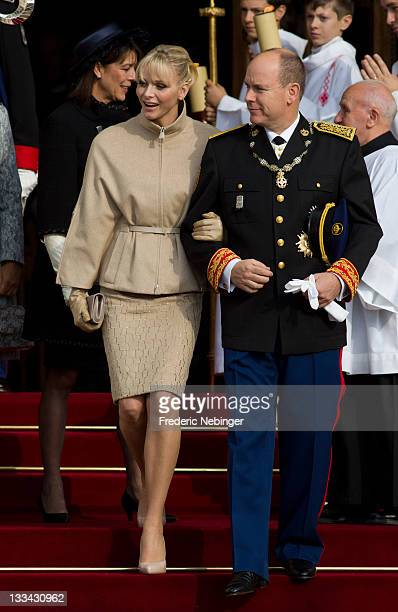 Prince Albert II of Monaco Princess Charlene of Monaco and Princess Caroline of Hanover leave the Cathedrale NotreDame Immaculee after attending a...