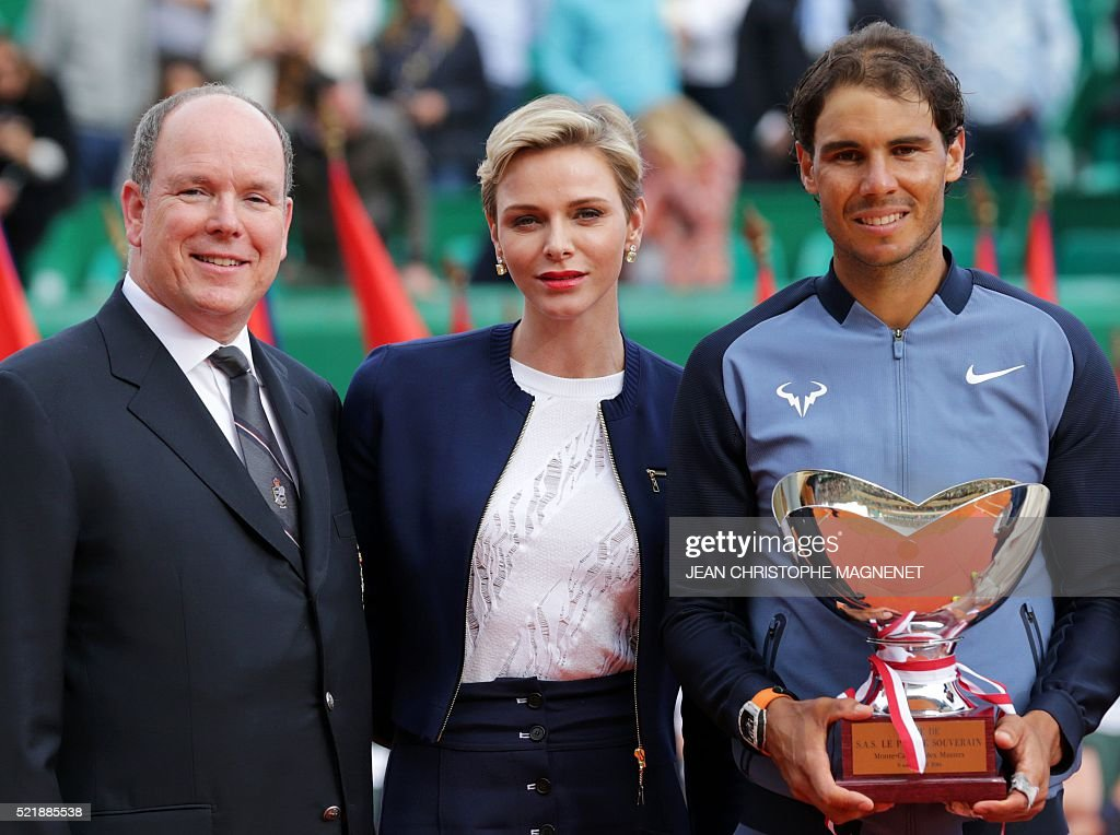 Prince Albert II of Monaco, Princess Charlene of Monaco and winner Spain's Rafael Nadal pose during the awarding ceremony following the final tennis match at the Monte-Carlo ATP Masters Series Tournament in Monaco on April 17, 2016. Nadal defeated Monfils 7-5, 5-7, 6-0 to win a record ninth title at the Monte Carlo Masters.