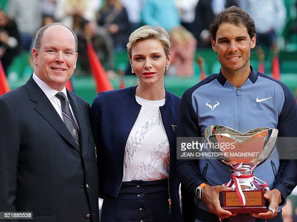 Prince Albert II of Monaco Princess Charlene of Monaco and winner Spain's Rafael Nadal pose during the awarding ceremony following the final tennis...