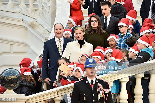 Prince Albert II of Monaco, Princess Charlene of Monaco, Camille Gottlieb and Louis Ducruet attend the Christmas gifts distribution on December 16,...