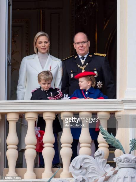 Prince Albert II of Monaco, Princess Charlene of Monaco, Prince Jacques and Princess Gabriela stand at the Palace balcony during the Monaco National...