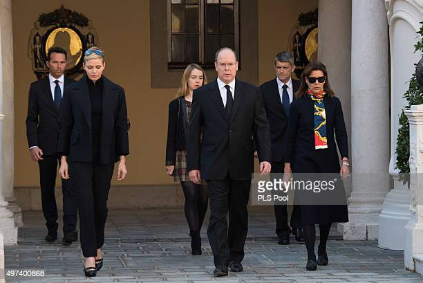 Prince Albert II of Monaco Princess Charlene of Monaco Princess Caroline of Hanover and Princess Alexandra of Hanover attend a minute of silence for...