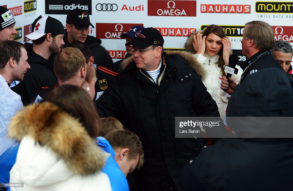 Prince Albert II of Monaco shakes hands with Maximilian Arndt and the other winning teams after the Four Men Bobsleigh final heat of the IBSF Bob & Skeleton World Championship at Olympia Bob Run on February 3, 2013 in St Moritz, Switzerland.