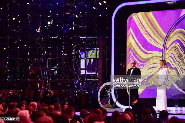 Prince Albert II of Monaco speaks on stage with his wife CharlenePrincess of Monaco during the 2018 Laureus World Sports Awards show at Salle des...