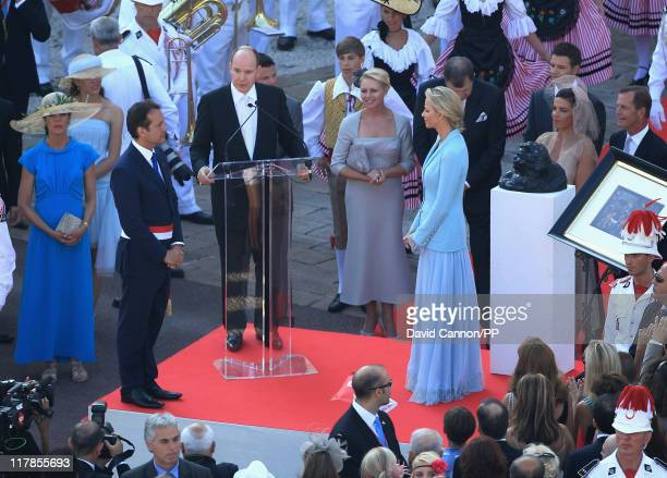 Prince Albert II of Monaco speaks to wellwishers as Princess Charlene of Monaco looks on after the civil ceremony of their Royal Wedding at the...
