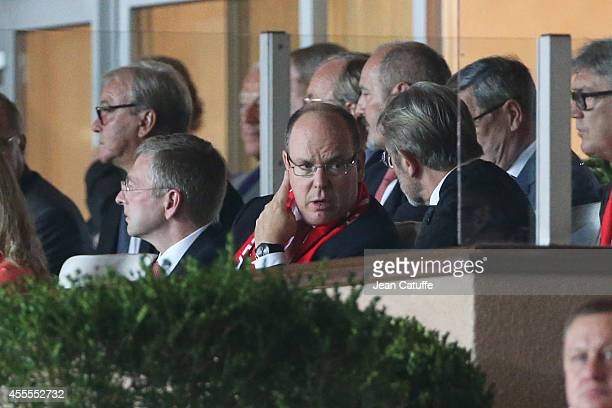 Prince Albert II of Monaco speaks with Frederic Thiriez President of the French League during the UEFA Champions League Group C match between AS...