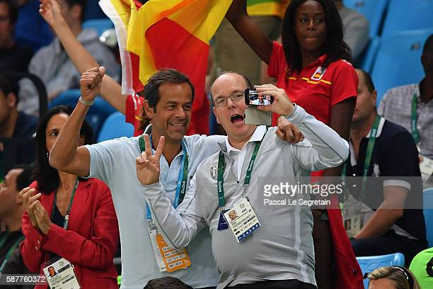 Prince Albert II of Monaco takes a selfie during the Men's round Group B basketball match between Spain and Brazil at the Carioca Arena 1 in Rio de...