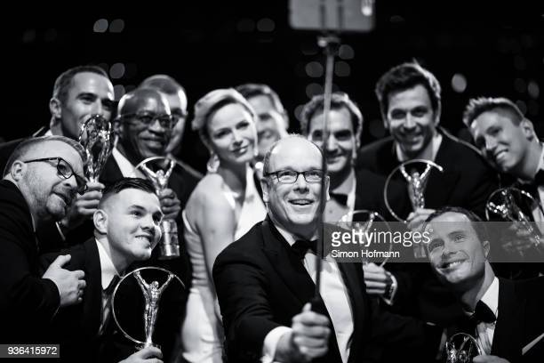 Prince Albert II of Monaco takes a selfie with all winners during the Show of the 2018 Laureus World Sports Awards at Salle des Etoiles Sporting...