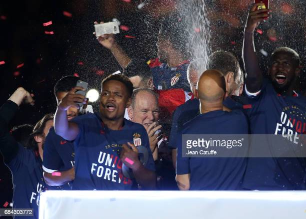 Prince Albert II of Monaco takes a shower of champagne with the players of AS Monaco during the French League 1 Championship title celebration...
