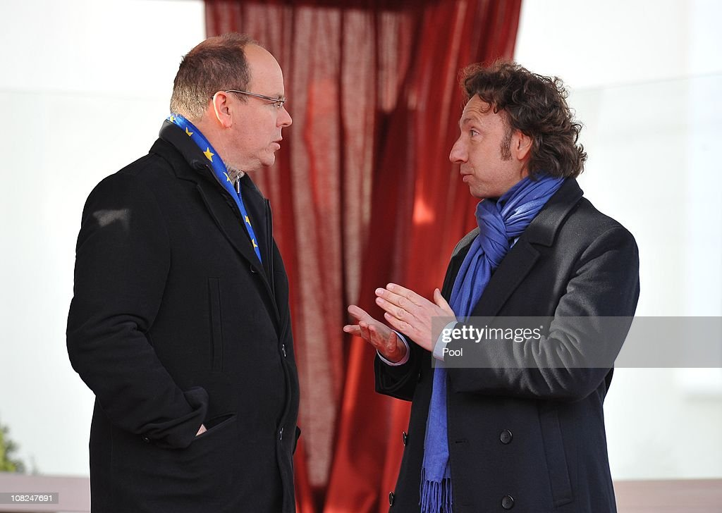 Prince Albert II of Monaco talks with television presenter Stephane Bern (R) during the Grand Parade for the 35th Monte-Carlo International Circus Festival as it passes through the Place du Palais and the streets of the Principality on January 22, 2011 in Monte-Carlo, Monaco.