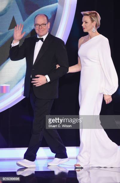 Prince Albert II of Monaco walks on stage with his wife CharlenePrincess of Monaco during the 2018 Laureus World Sports Awards show at Salle des...