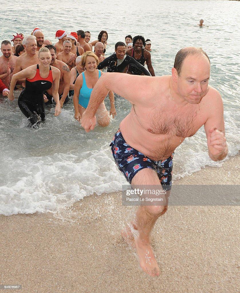 Prince Albert II of Monaco walks on the beach after the Annual Charity Christmas Swim for TATSA Association on December 20, 2009 in Monaco, Monaco.