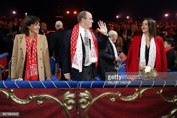 Prince Albert II of Monaco waves flanked by his sister Princess Stephanie and her daughter Pauline Ducruet as they arrive for the 5th New Generation...
