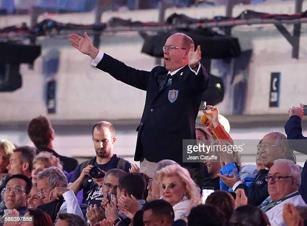 Prince Albert II of Monaco waves to his delegation during the opening ceremony of the 2016 Summer Olympics at Maracana Stadium on August 5 2016 in...