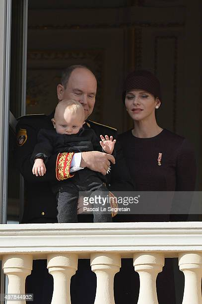Prince Albert II of Monaco with Prince Jacques and Princess Charlene of Monaco greet the crowd from the palace's balcony during the Monaco National...