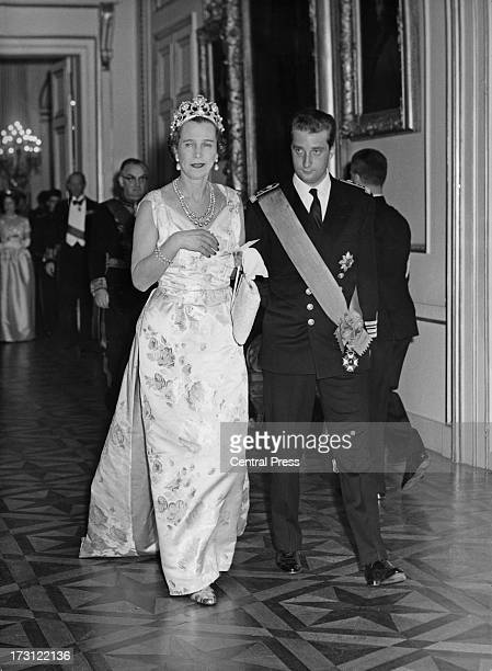 Prince Albert of Belgium escorts ExQueen Marie Jose of Italy to a banquet at the Royal Palace of Brussels 14th December 1960 The banquet is taking...