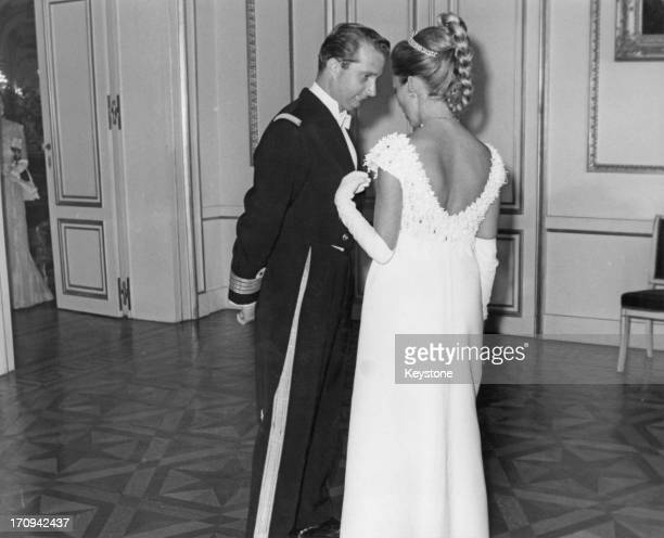 Prince Albert of Belgium later King Albert II of Belgium and Princess Paola of Belgium have a quiet word together before the State Dinner with Queen...