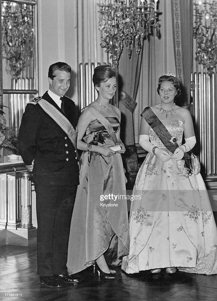 Prince Albert of Belgium, later King Albert II of Belgium (left) and Princess Paola of Belgium (later Queen Paola of Belgium) (centre) with Princess Beatrix of the Netherlands during a state visit from the Dutch Royals to Brussels, 1st June 1960.