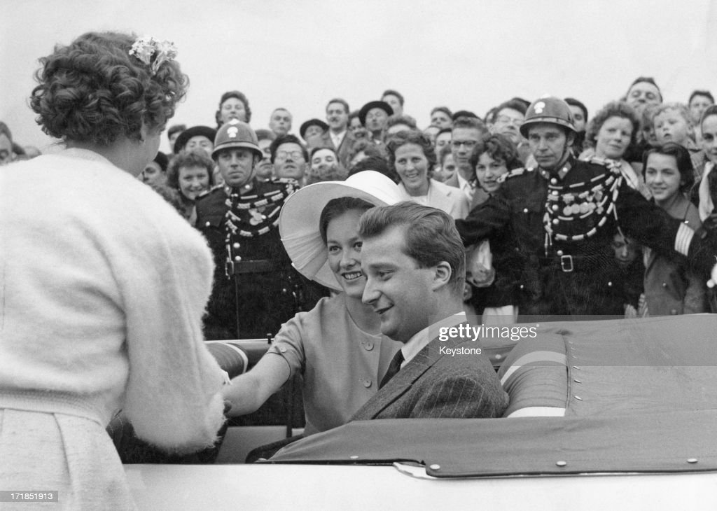 Prince Albert of Belgium, later King Albert II of Belgium and Princess Paola of Belgium (later Queen Paola of Belgium) greet fans whilst attending the Red Cross Ceremonies at Lanaken, Belgium, 31st May 1960.
