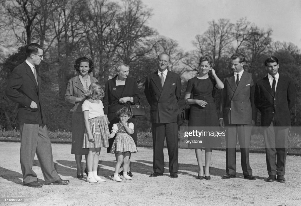 Prince Albert of Belgium, later King Albert II of Belgium and Princess Paola of Belgium (later Queen Paola of Belgium) announce their engagement to the press and pose for a family photo. L - R; King Baudouin of Belgium (1930 - 1993), Princess Lilian of Belgium (1916 - 2002) with Princess Marie-Christine of Belgium and Princess Maria-Esmeralda of Belgium, Donna Luisa Ruffo di Calabria, King Leopold III of Belgium (1901 - 1983), Princess Paola of Belgium, Prince Albert of Belgium, later King Albert II of Belgium, Prince Alexander of Belgium (1942 – 2009), 13th April 1959.