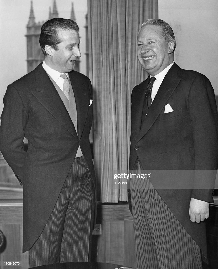 Prince Albert of Belgium, later King Albert II of Belgium, in London for the Belgian Trade Mission, arrives at the Board of Trade and is greeted by Edward Heath (1916 - 2005), Secretary of State for the Board of Trade, 16th March 1964.