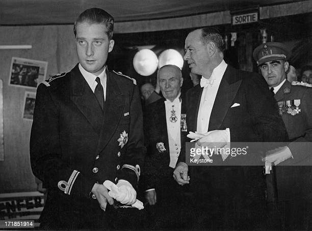 Prince Albert of Belgium, later King Albert II of Belgium is received by the U.S. Ambassador to Belgium whilst attending a Gala cinema show organised...
