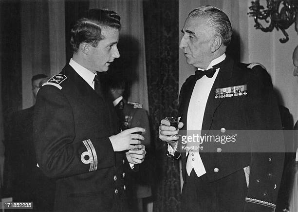 Prince Albert of Belgium, later King Albert II of Belgium talks to Admiral Sala of the Supreme Allied Command in Europe during a dinner party given...