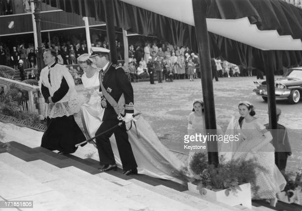 Prince Albert of Belgium later King Albert II of Belgium walks Princess Paola of Belgium up the steps of the Cathedral of St Michael and St Gudula...