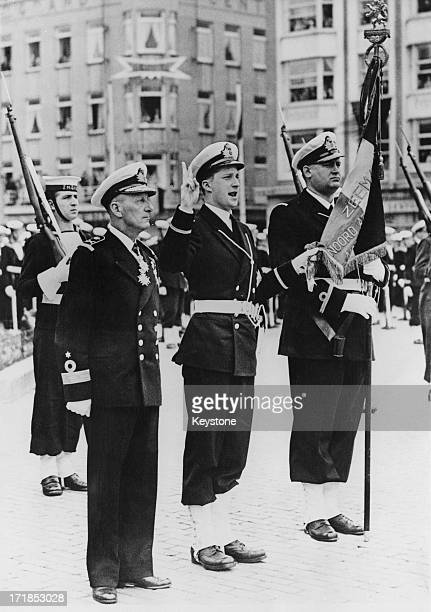 Prince Albert of Belgium later King Albert II of Belgium who has been gazetted as 'Aspirant de Marine' in the Belgian Navy takes the oath with...