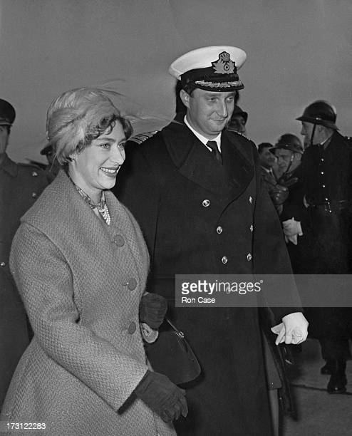 Prince Albert of Belgium meets with Princess Margaret Countess of Snowdon on her arrival at Brussels Airport 13th December 1960 Princess Margaret is...