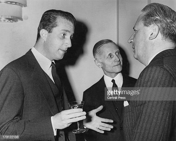 Prince Albert of Belgium talks to Edward Heath and Belgian Ambassador, Baron Jacques de Thier . Prince Albert is in London to address a dinner for...