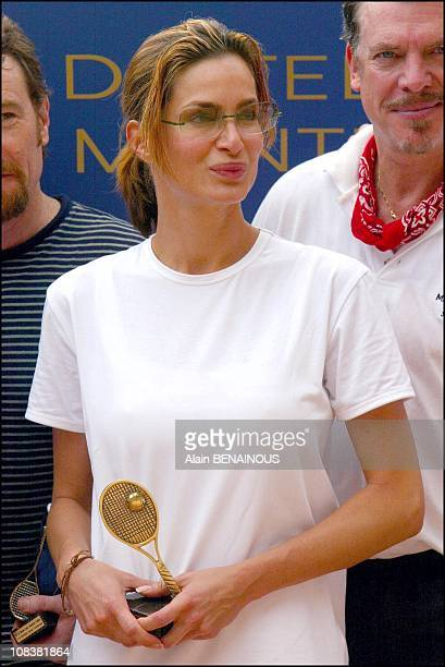 Prince Albert of Monaco and his friend Alexandra Kamp participate in tennis tournament of the forty-second film festival of Monaco on July 06, 2002.