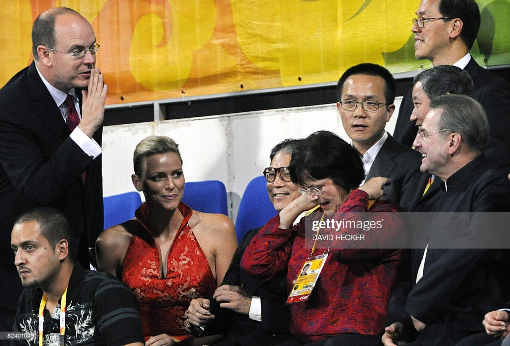 Prince Albert of Monaco (L) and his girlfriend Charlene Wittstock (2nd) attend the equestrian jumping individual 3rd Qualifier of the 2008 Beijing Olympic Games on August 18, 2008 in Hong Kong. PHOTO
