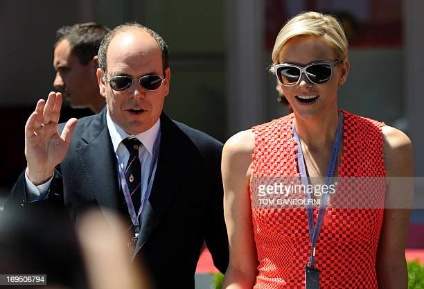 Prince Albert of Monaco and Princess Charlene of Monaco arrive at the track before the Monaco Formula One Grand Prix at the Circuit de Monaco in...