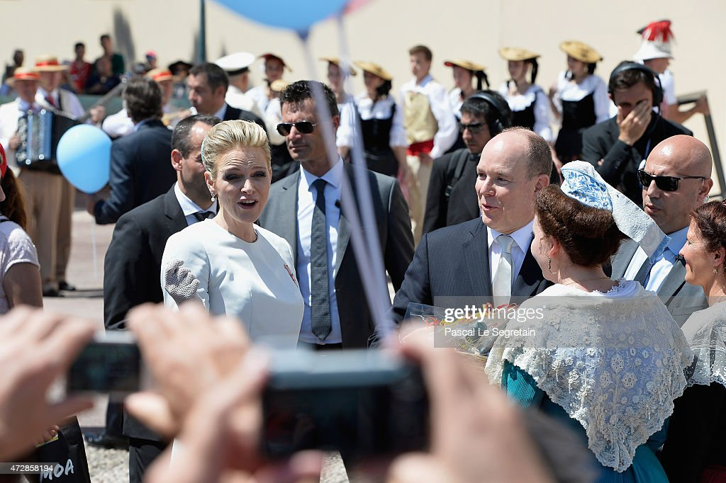 Prince Albert of Monaco and Princess Charlene of Monaco walk on The Palace Square after the Baptism of their twins on May 10, 2015 in Monaco, Monaco.
