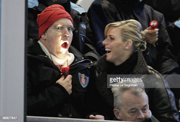 Prince Albert of Monaco and swimmer Charlene Wittstock attend the Opening Ceremony of the Turin 2006 Winter Olympic Games on February 10 2006 at the...