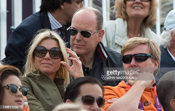 Prince Albert of Monaco and The Netherlands' Crown Prince Willem Alexander and Crown Princess Maxima spectate during the the team Show Jumping event...