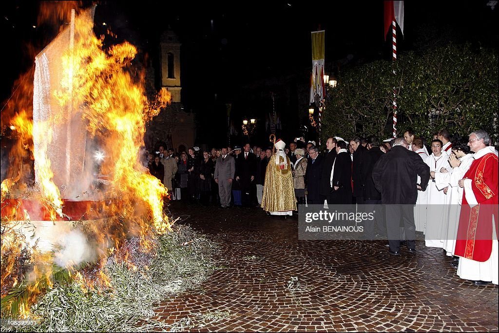 Prince Albert of Monaco at the celebration of the Saint Devote. The legend of Devote, the country's patron saint and founder, is a cherished part of Monegasque heritage. Every year on the 26th of January a torchlight ceremony is held for her at the Church of St Devote. According to the tradition, a small boat is set alight on the harbor, by the 'Vallon des Gaumattes', with the participation of the Grimaldi family. This very symbolic celebration can be explained thanks to the story of Sainte Devote. She was most certainly born in Corsica, in the year 283 A.D.; she was hounded and tortured because of her Christian faith. When her wounded body was being burnt at the stake, confessors of the faith snatched it away and escaped by boat with the intention of going to Africa. Unfortunately, the winds were not favorable and the sailors fell asleep. A dream instructed them to continue their journey and follow a dove. They finally arrived near Monachon, in the 'Vallon Gannates' (Vallon des Gaumattes) where the body of the martyr was laid to rest. Subsequently, a few miracles occurred, people spread the news and Devote became the Patron Saint of Monaco in Monaco on January 26, 2007.