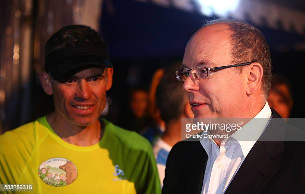 Prince Albert of Monaco chats with Christophe Santini during the Ironman France on June 05 2016 in Nice France