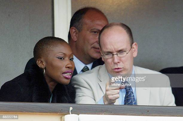 Prince Albert of Monaco chats with Nicole Coste as they watch a match from his private box at the Monaco Tennis Open in April 2002 in Monaco Prince...