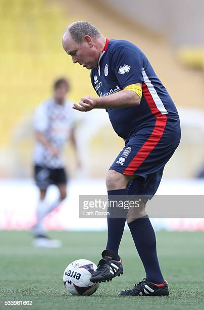 Prince Albert of Monaco controls the ball during the 24th World Stars football match at Stade Louis II Monaco before the Monaco Formula One Grand...
