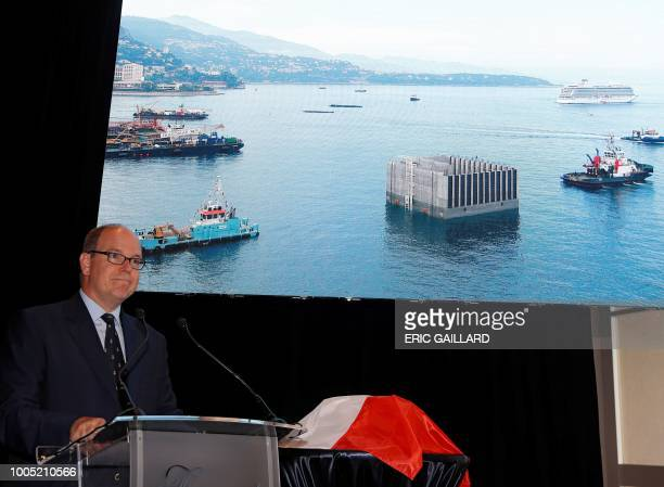 Prince Albert of Monaco delivers a speech on principality's offshore land reclaimation extension project concretefilled chambers called caissons...