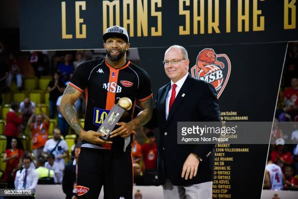 Prince Albert of Monaco gives the award to Romeo Travis of Le Mans during the Final Jeep Elite match between Monaco and Le Mans on June 24 2018 in...