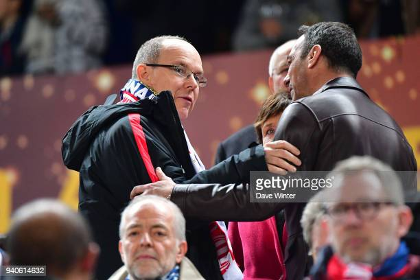 Prince Albert of Monaco greets former Monaco player Youri Djorkaeff during the Final of the French League Cup between Paris Saint Germain and AS...