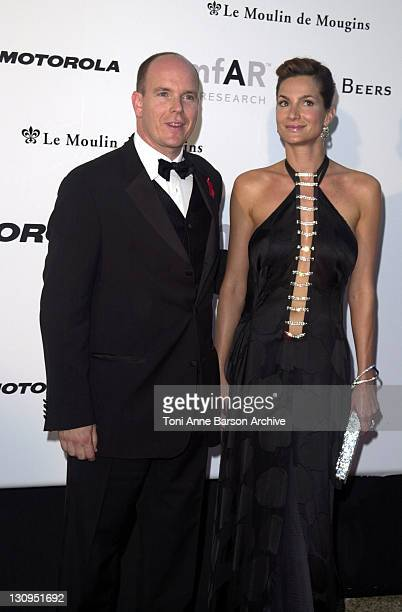 Prince Albert of Monaco & guest during Cannes 2002 - amfAR's Cinema Against AIDS Gala sponsored by Motorola and co-sponsored by De Beers - Arrivals...