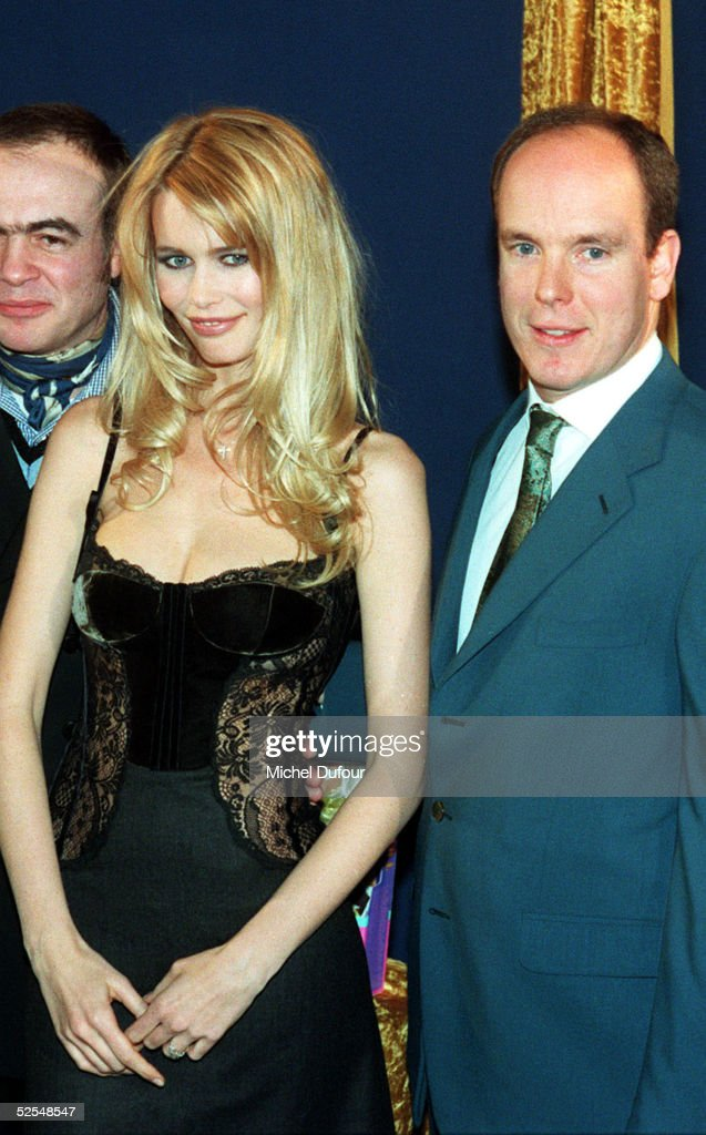 Prince Albert of Monaco (R) is seen with model Claudia Schiffer and designer Lacroix in Paris in 1996, France. With the deteriorating health of his father Prince Rainier, Prince Albert is next in line to the throne to take over as Monaco's ruler.