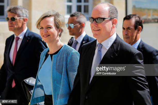 Prince Albert of Monaco is welcomed by Bordeaux Deputy Mayor Virginie Calmels before a visit at the city hall of Bordeaux on July 5 2017 / AFP PHOTO...