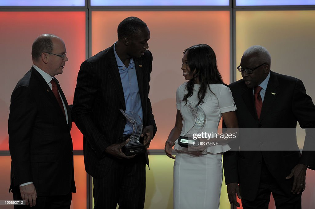 Prince Albert of Monaco, Jamaican athlete Usain Bolt, US sprinter Allyson Felix and IAAF (International Association of Athletics Federations) President Lamine Diack raect after posing for photographers during the IAAF´s Athlete of the Year Award marking its centenary on November 24, 2012 in Barcelona.