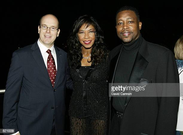 Prince Albert of Monaco Natalie Cole and Kenneth Dupree arrive for the Laureus Sport for Good Foundation Dinner at the Salles des Etoiles in the...